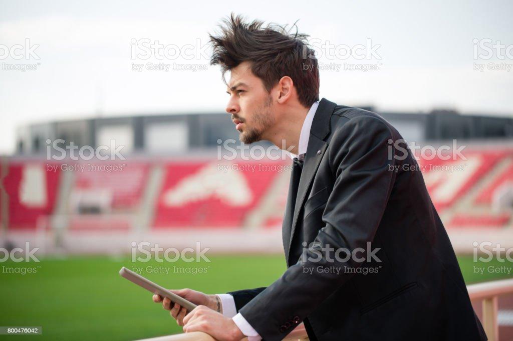 Man standing on stadium stock photo