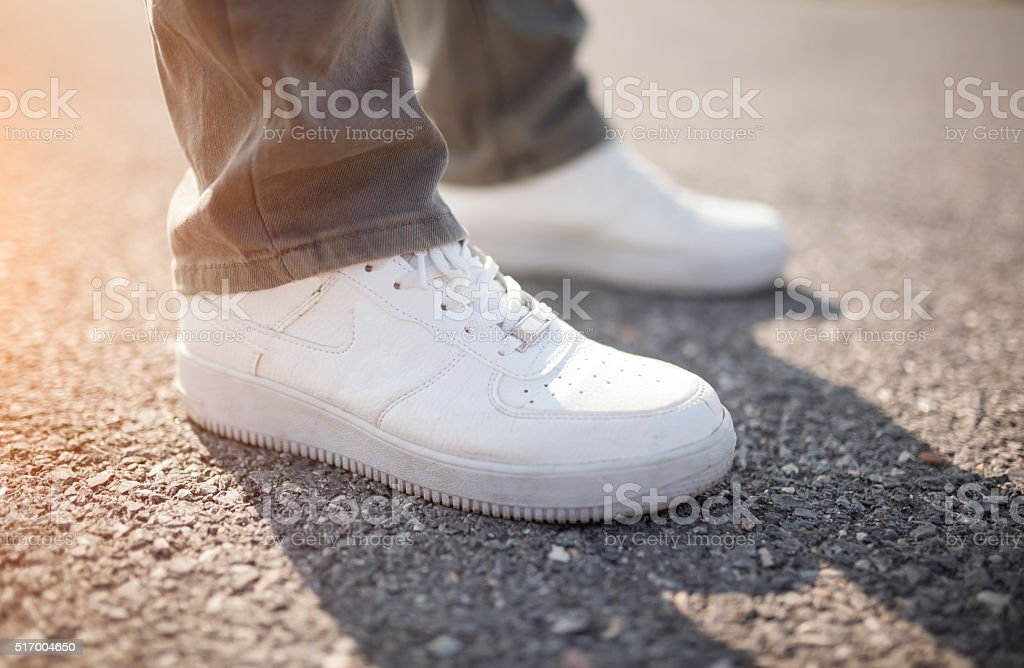 Man Standing on the asphalt stock photo