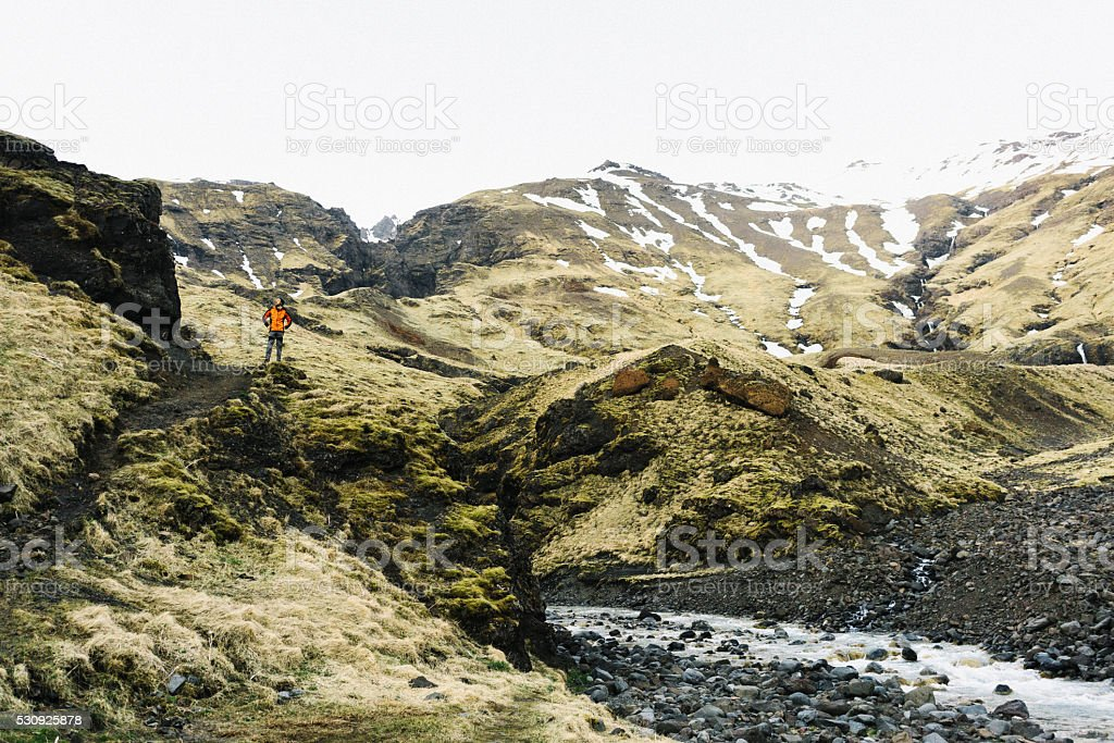Man standing on the hill stock photo