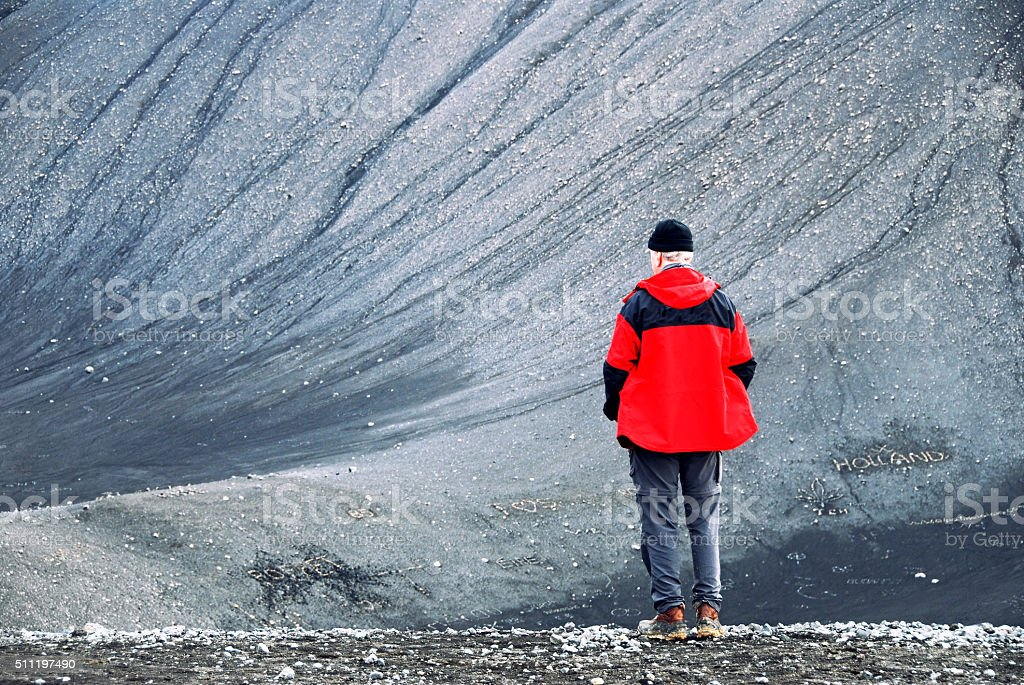 Man standing on the Hverfjall crater ,Myvatn region,Iceland stock photo