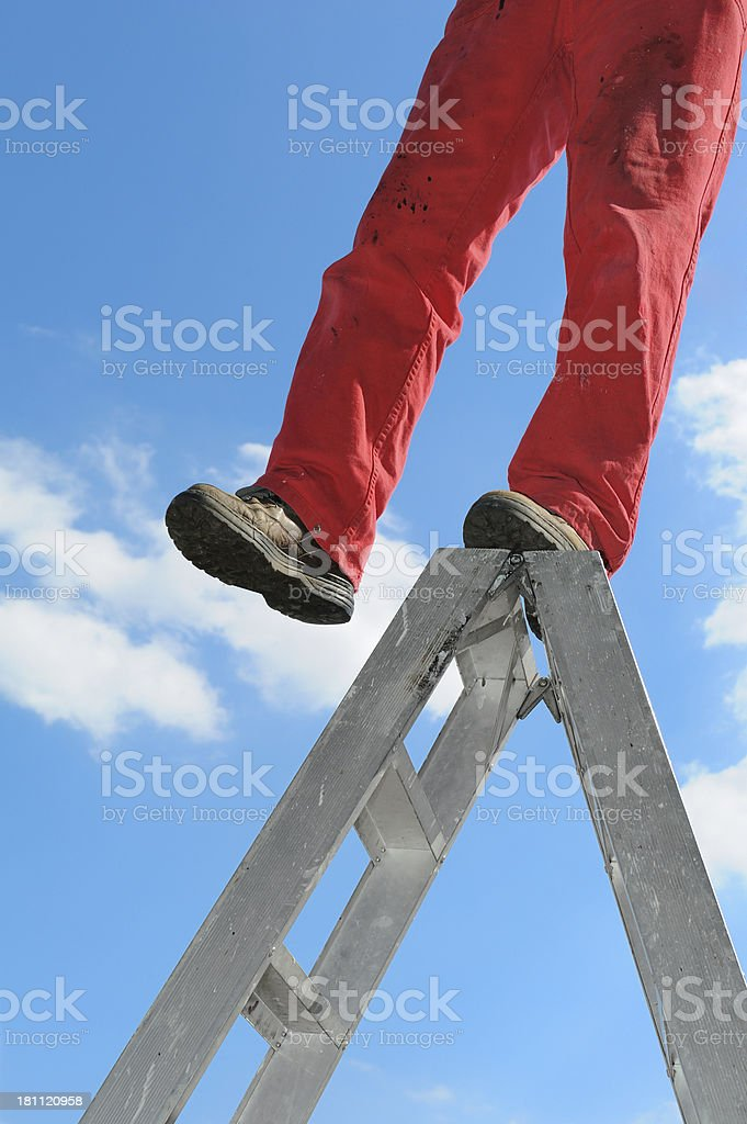 Man standing on the ladder royalty-free stock photo