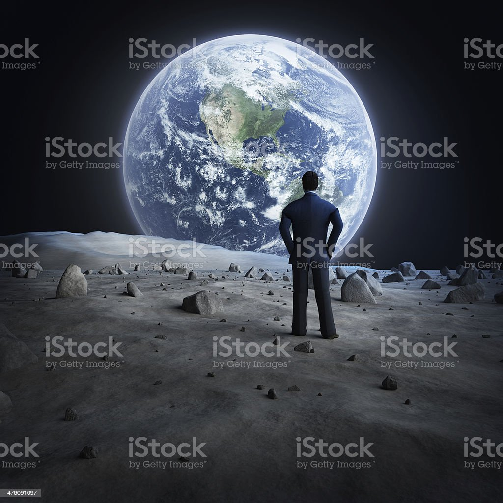 Man standing on the moon, looking at Earth royalty-free stock photo