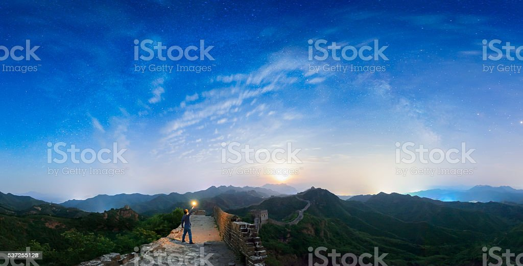 Man standing on the top of The great wall at moonrise stock photo