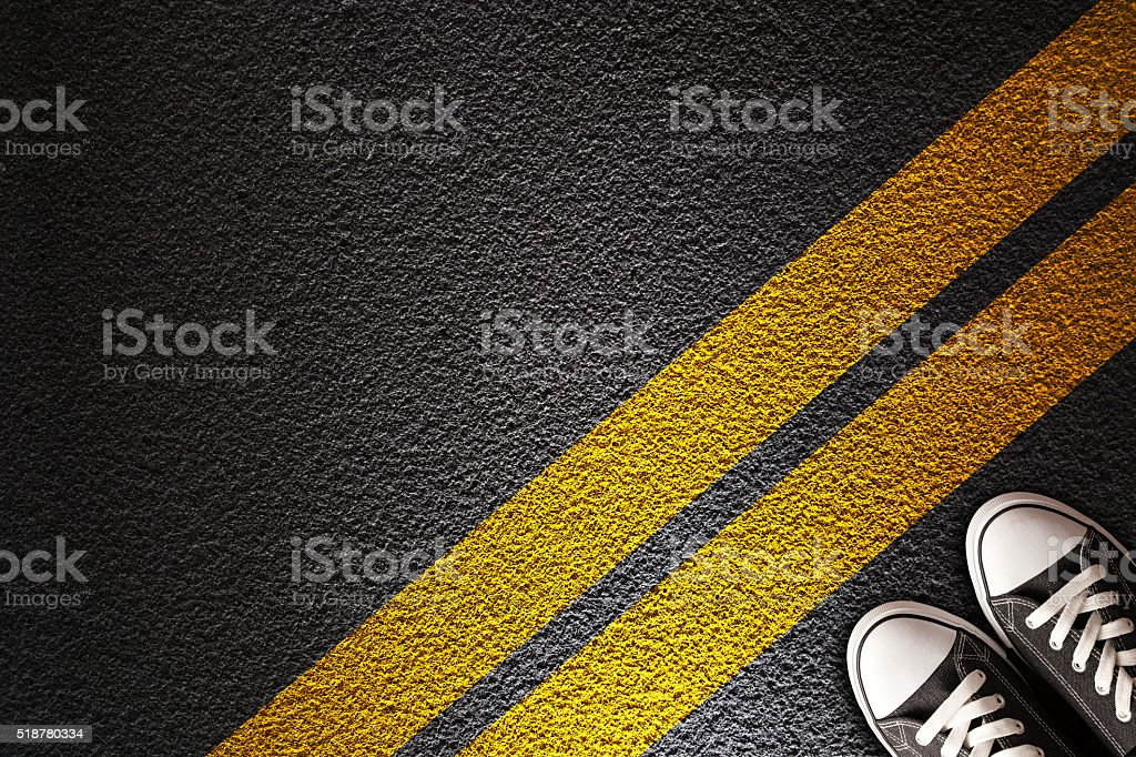 Man Standing on the yellow line stock photo