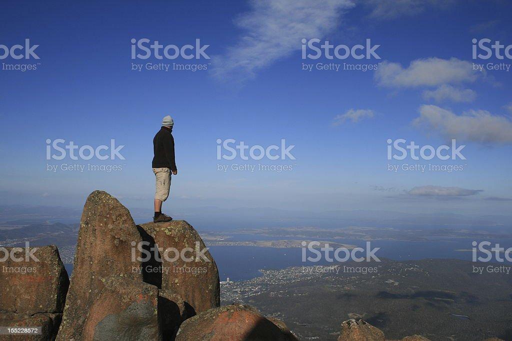 Man standing on top of a Mountain, Tasmania stock photo