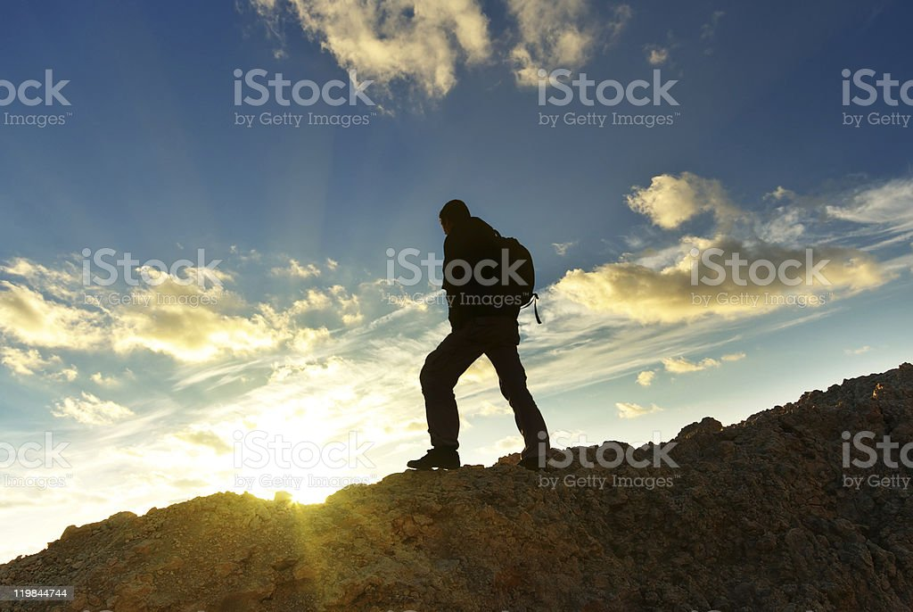 A man standing on top of the mountain royalty-free stock photo