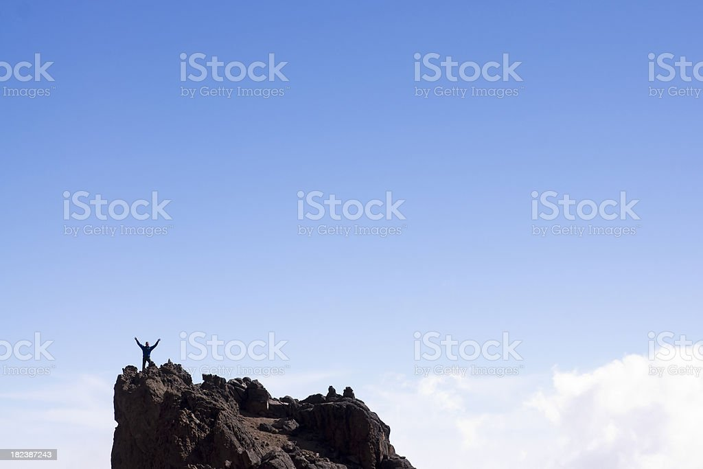 Man standing on top of the world royalty-free stock photo