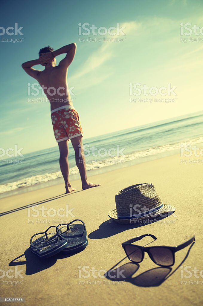 Man Standing On Vintage Vacation Beach royalty-free stock photo