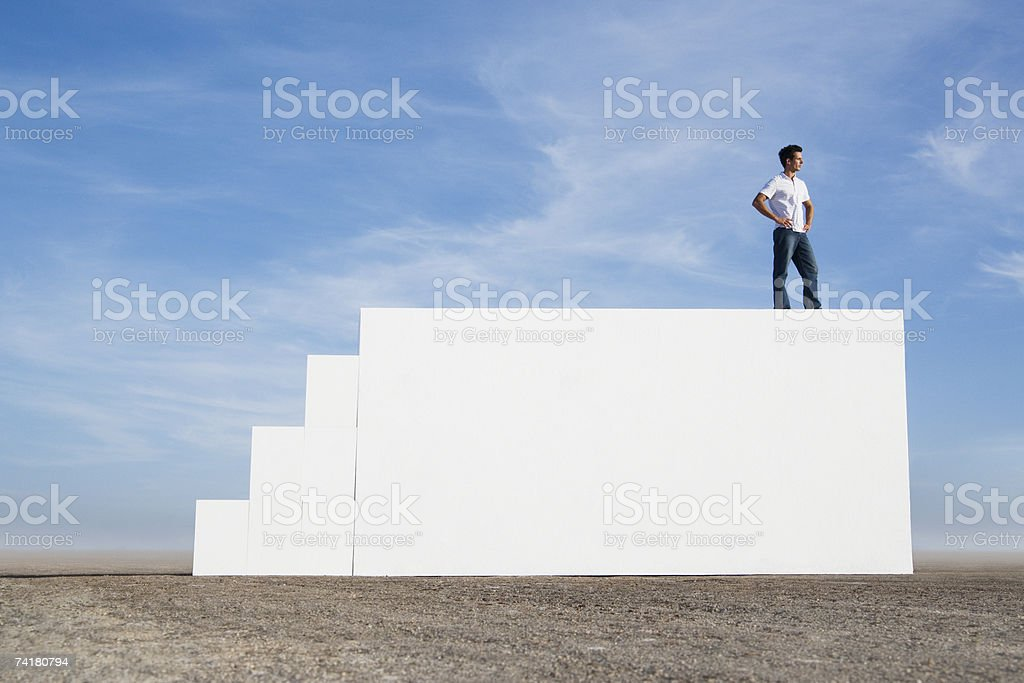 Man standing on wall outdoors with steps royalty-free stock photo