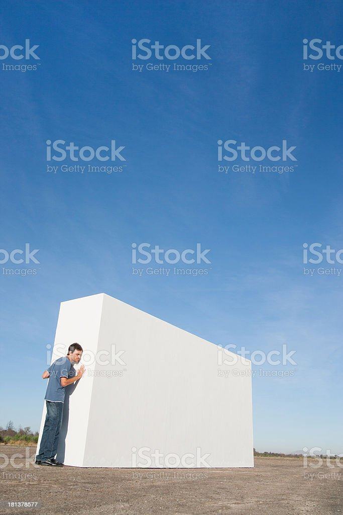 Man standing outdoors looking at white wall royalty-free stock photo