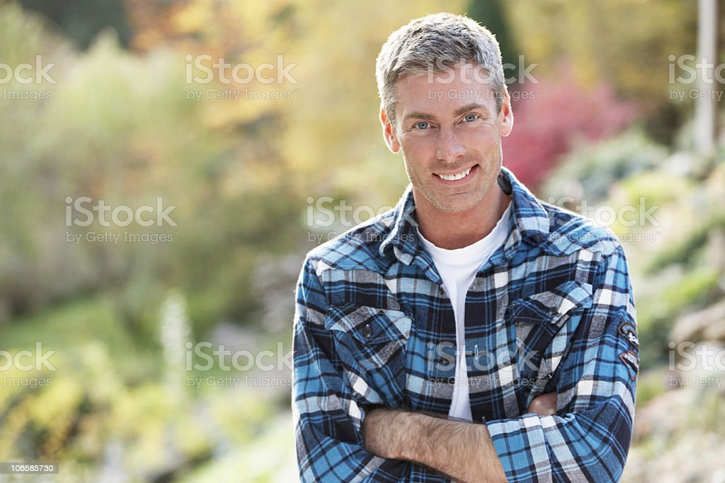 Man Standing Outside In Autumn Landscape stock photo