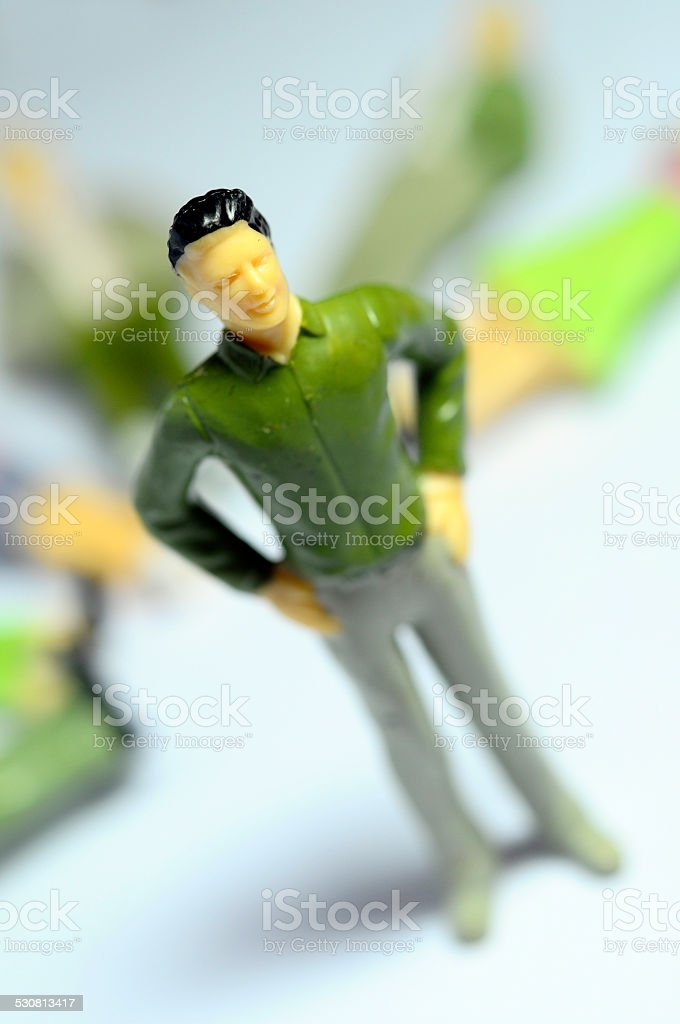Man standing over lying figures stock photo