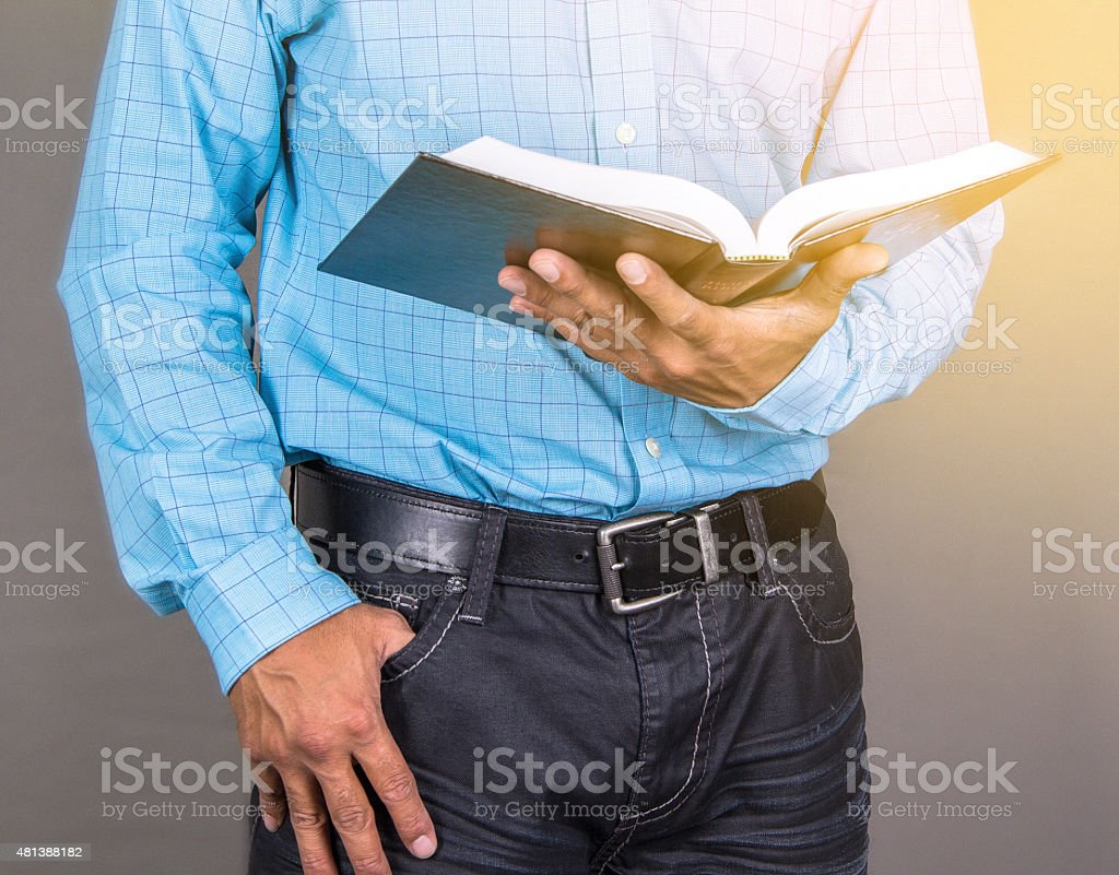 Man Standing Reading The Bible stock photo