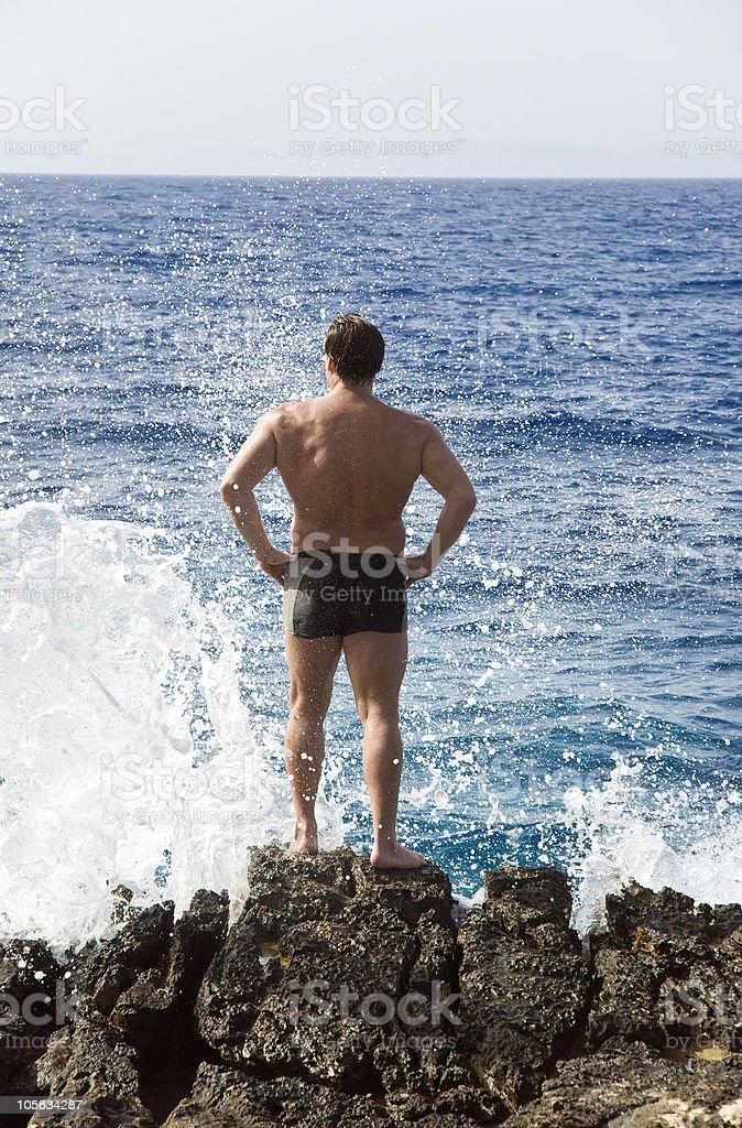 man standing rocks stock photo