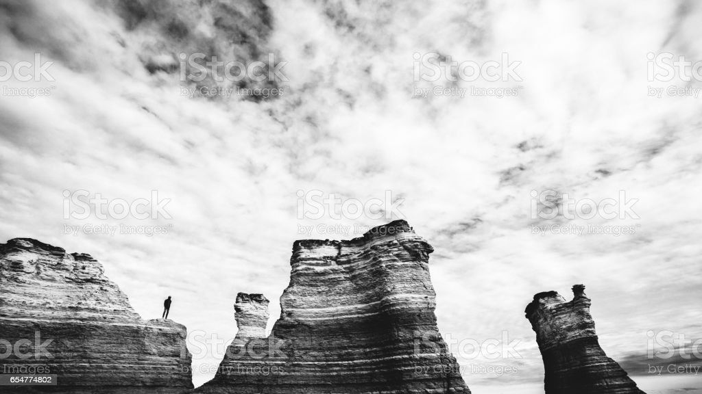 Man standing the rocks, Kansas. stock photo