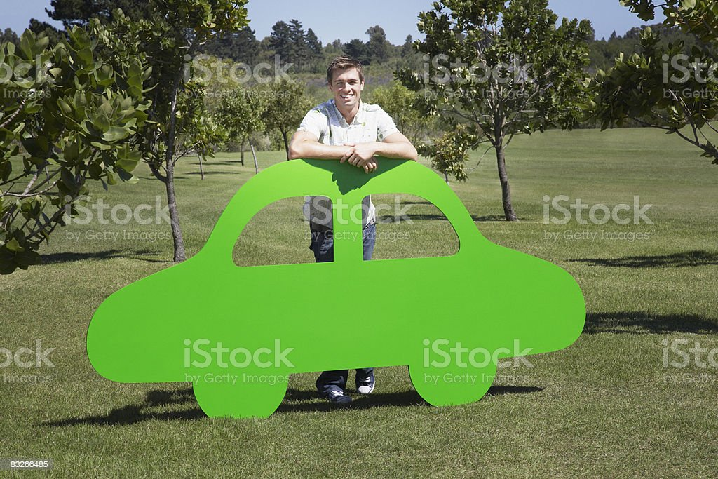 Man standing with cutout car stock photo