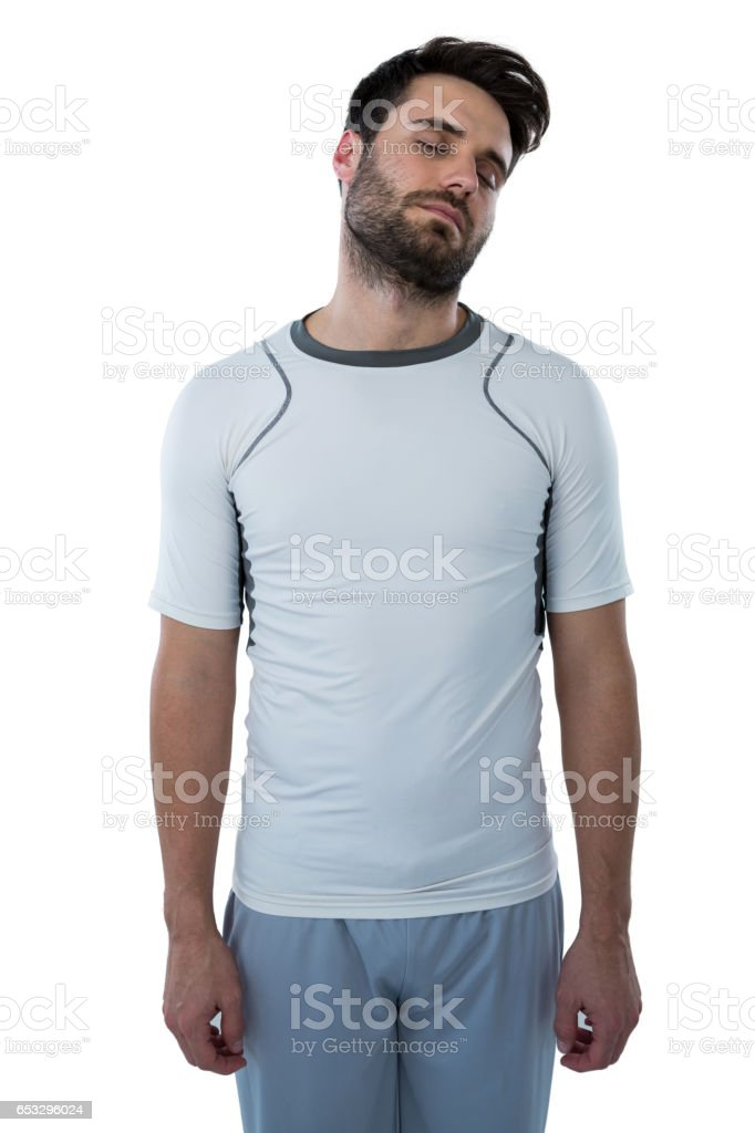 Man standing with eyes closed stock photo