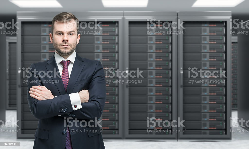 man standing with hands crossed stock photo