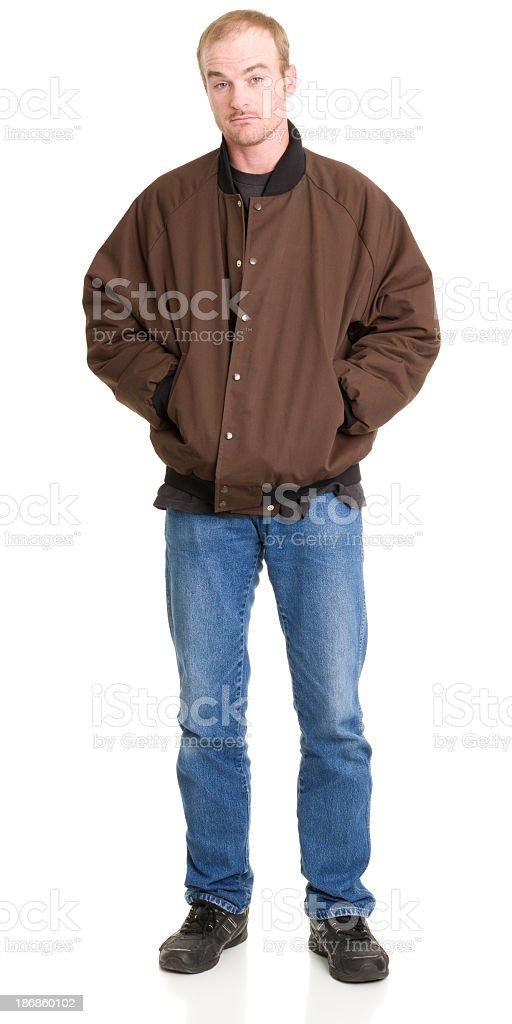 Man Standing With Hands In Jacket stock photo