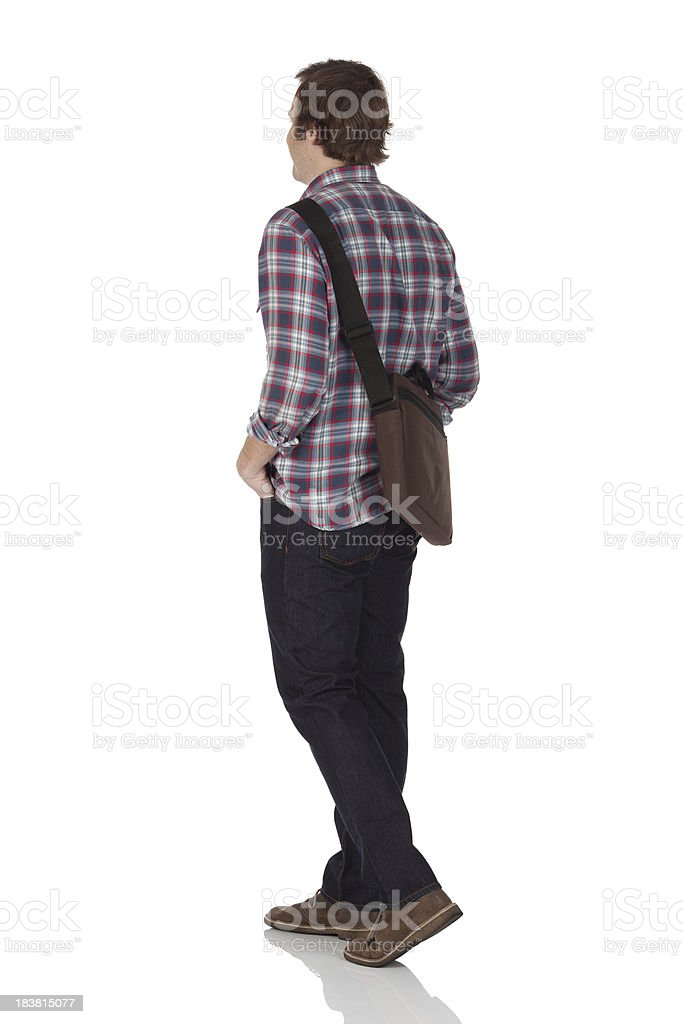 Man standing with hands in pockets royalty-free stock photo