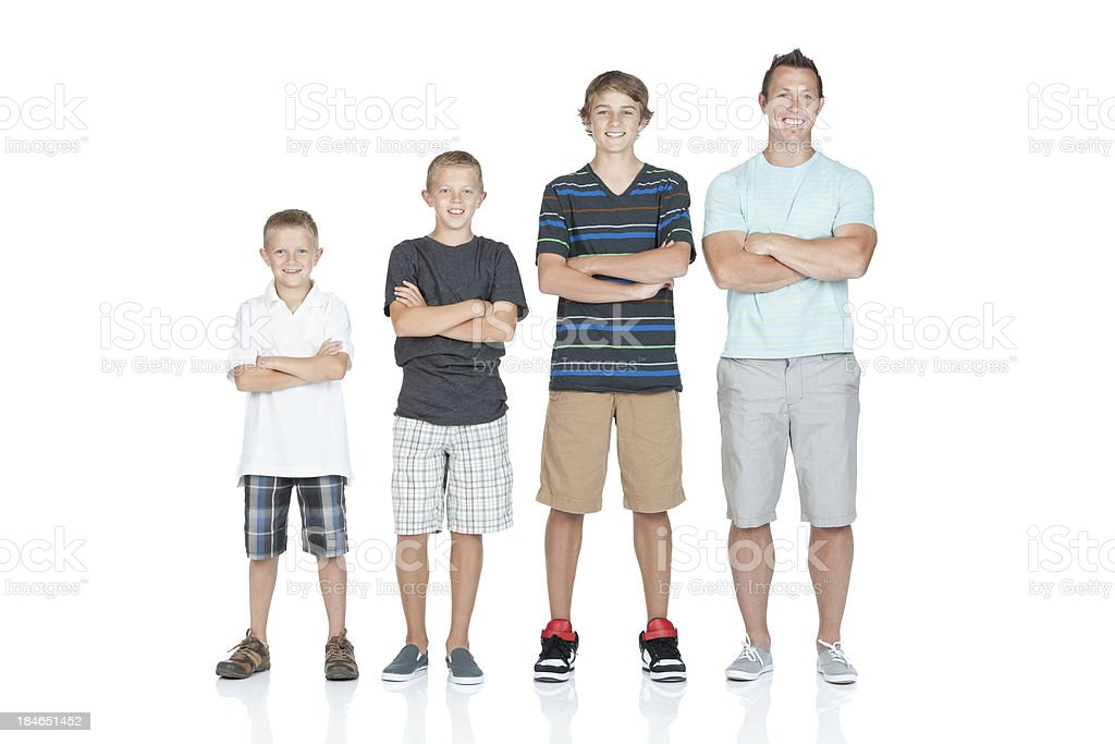Man standing with his children in ascending order stock photo