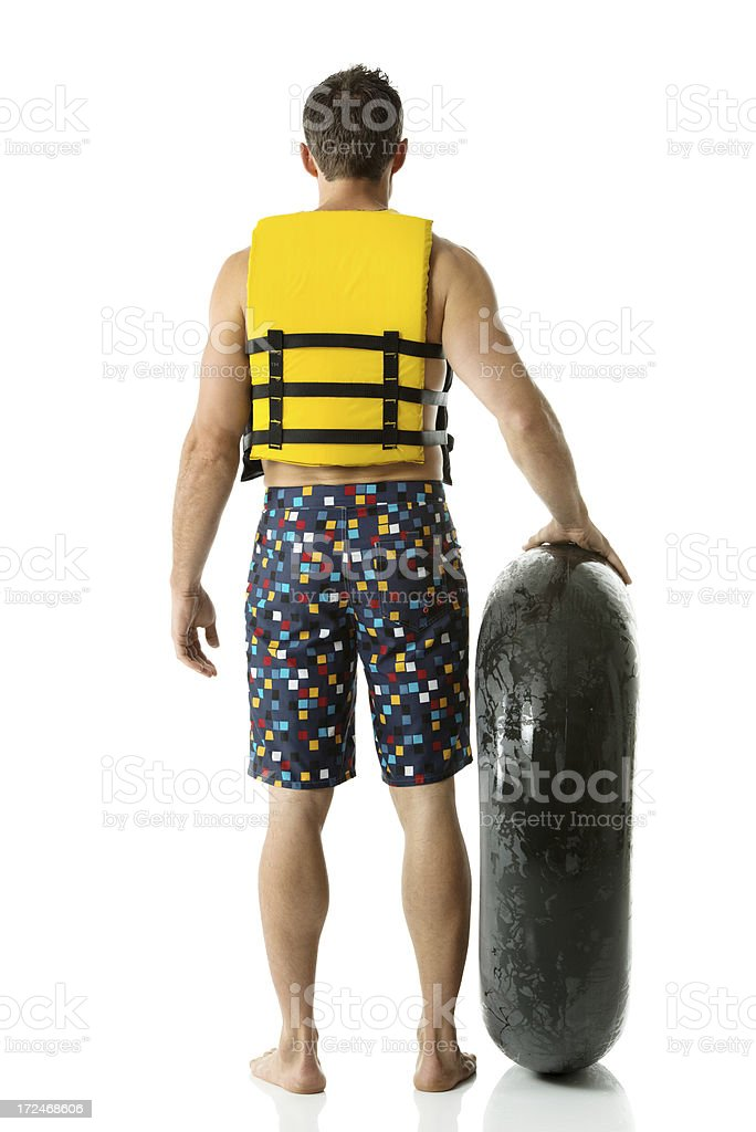 Man standing with inner tube royalty-free stock photo