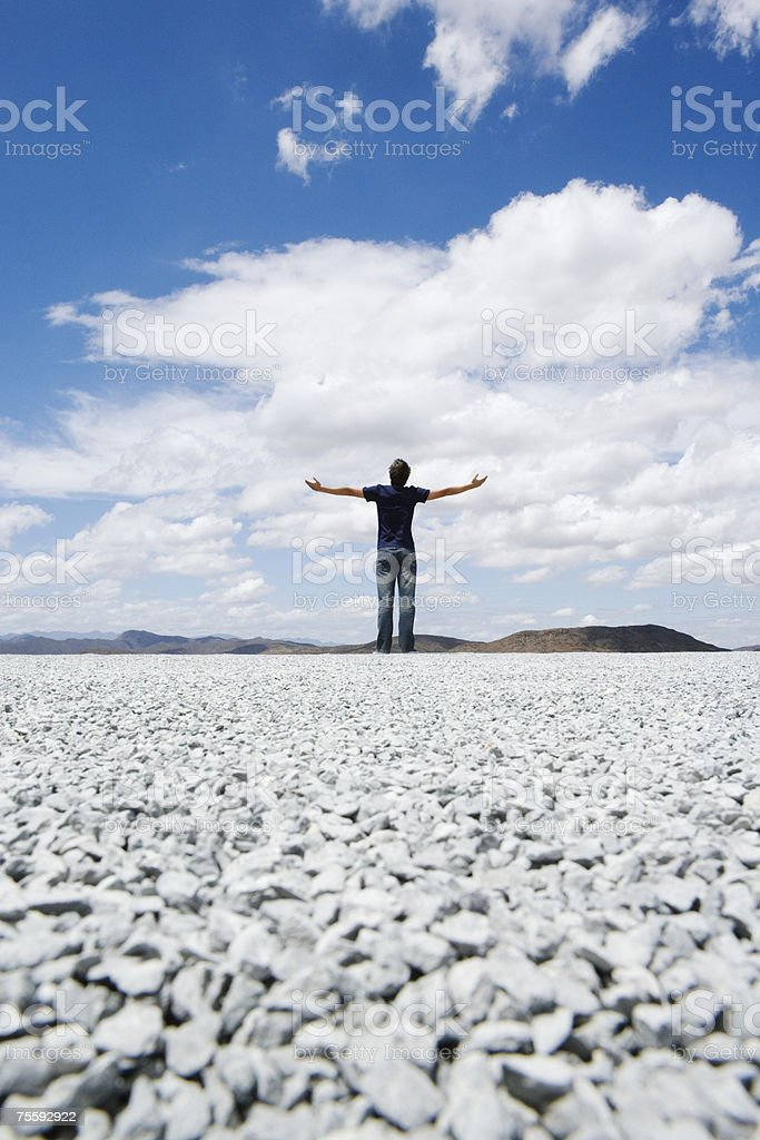 Man standing with outstretched arms royalty-free stock photo