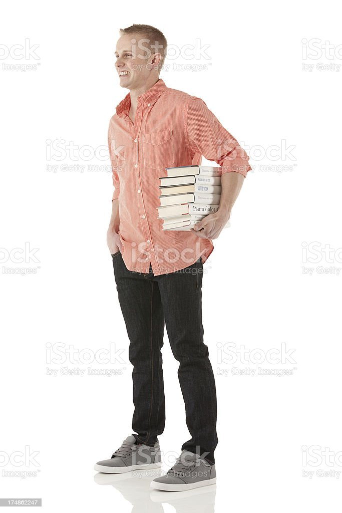 Man standing with stack of books royalty-free stock photo