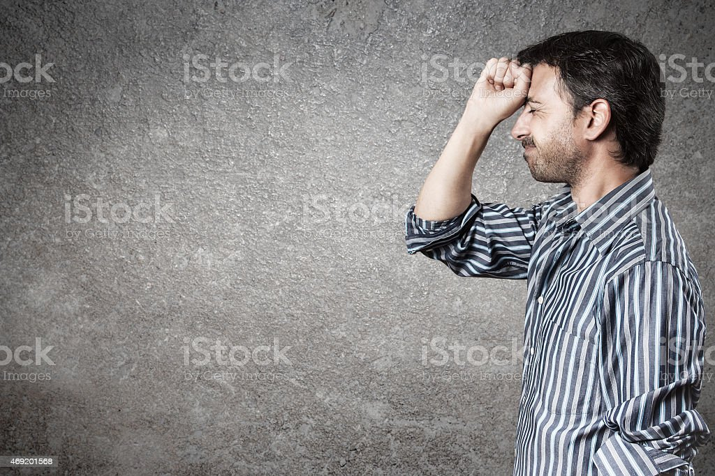 Man standing with striped shirt making a gesture of disappointment. stock photo