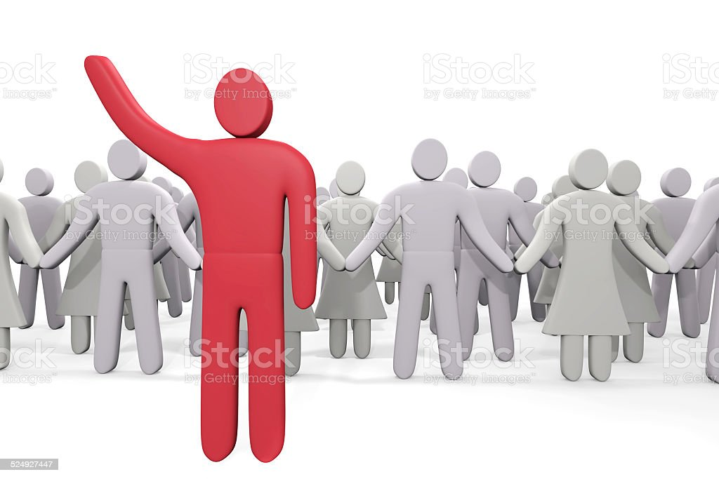 Man stands before crowd of people stock photo