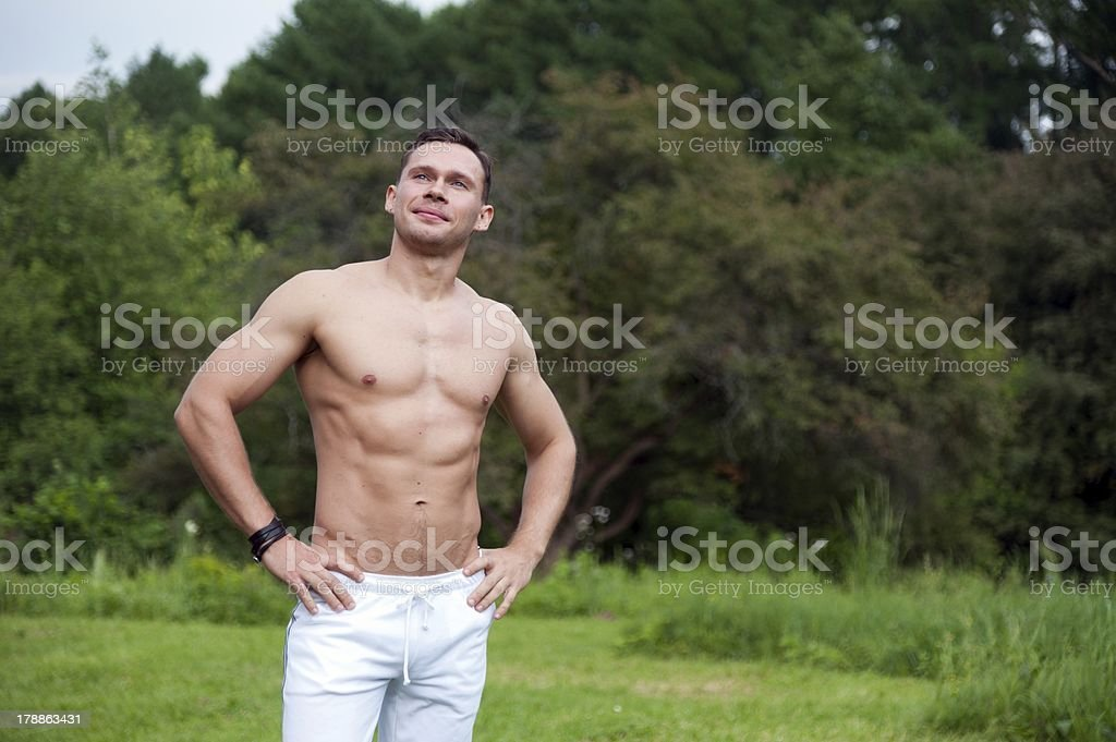 Man stands in park royalty-free stock photo