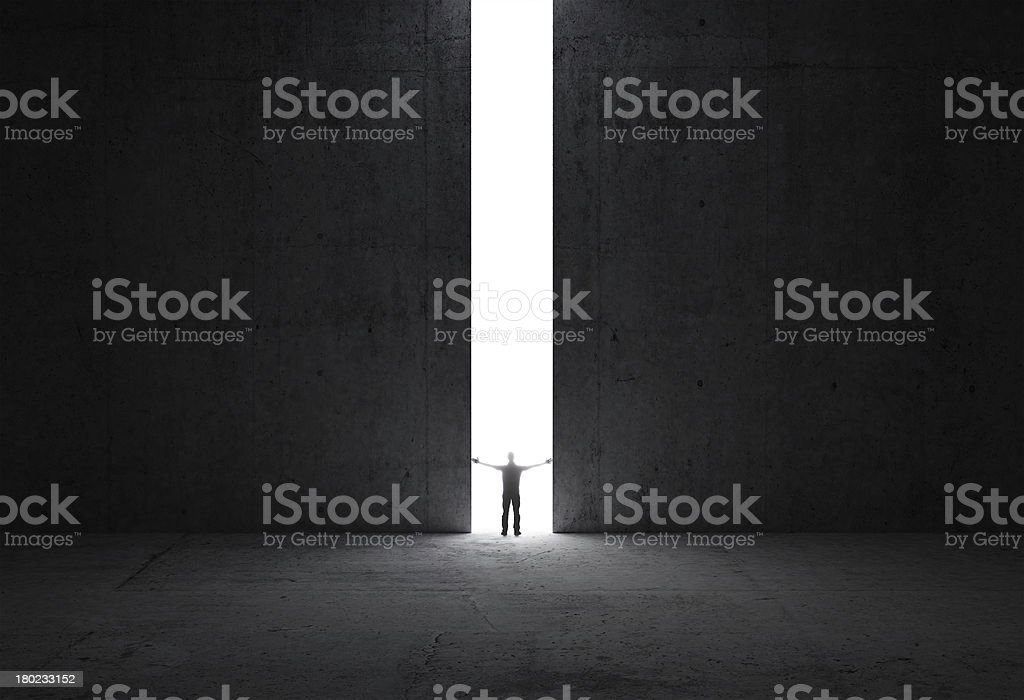 Man stands in the light of opening stock photo