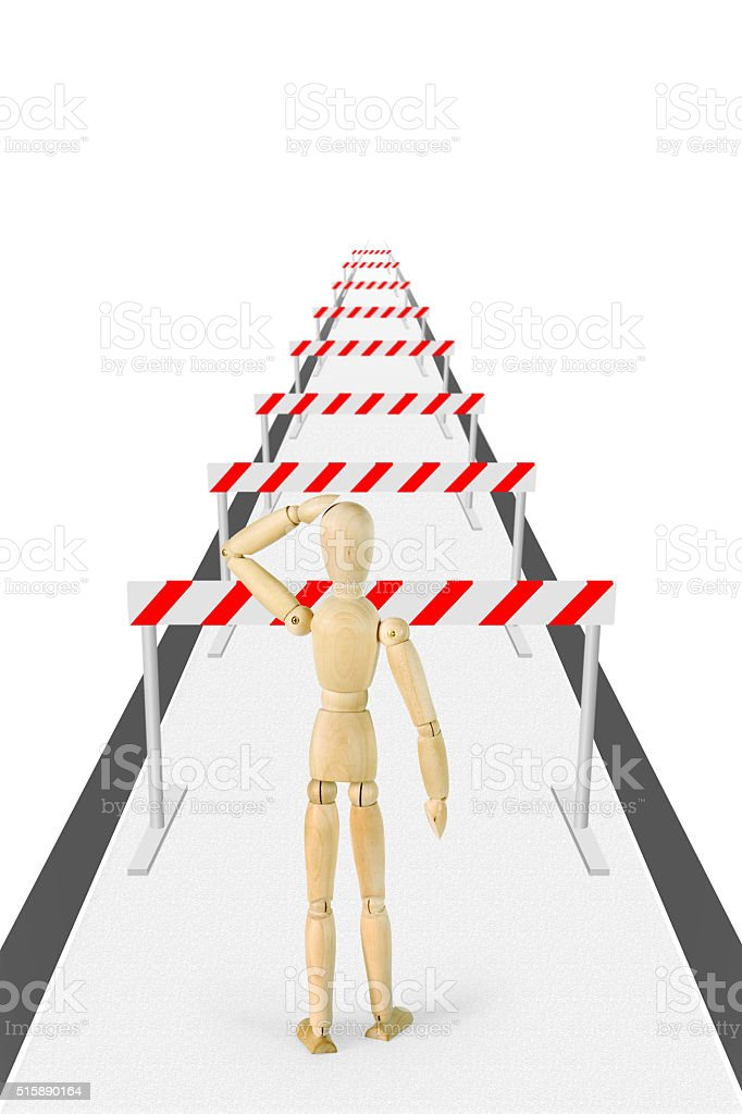 Man stands on the way with a lot of barriers stock photo