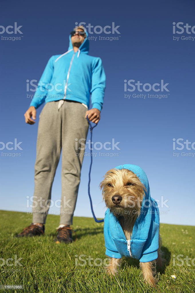 Man Stands with Dog in Matching Hoody Sweatshirt stock photo