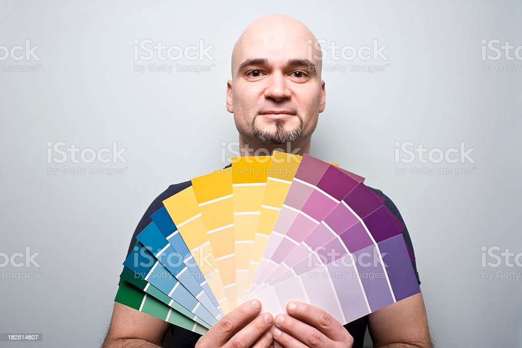 Man stands with Paint Charts Samples royalty-free stock photo