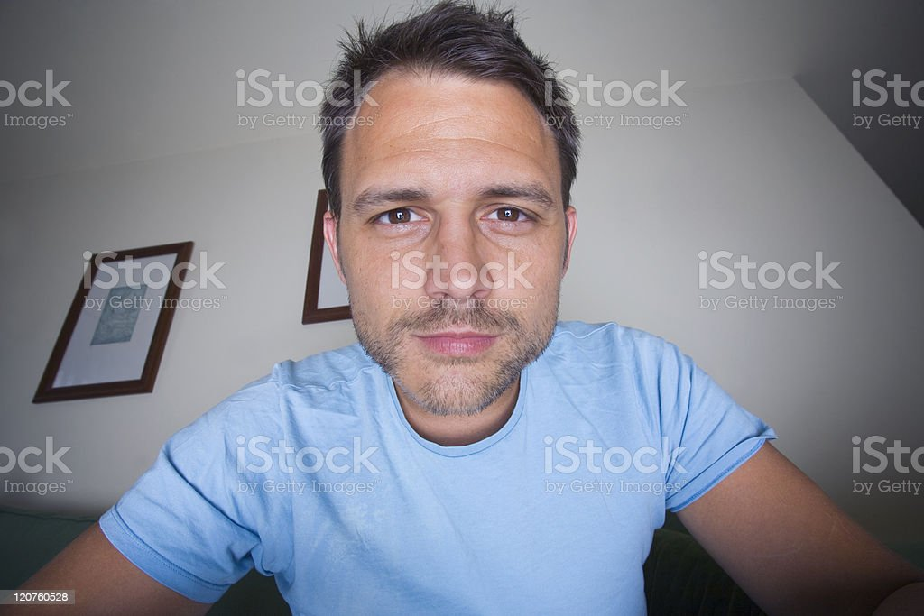 Man staring and smiling at camera for online photo stock photo