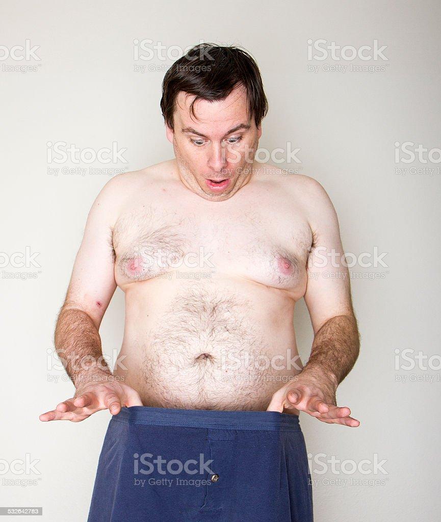 Man staring at his junk stock photo