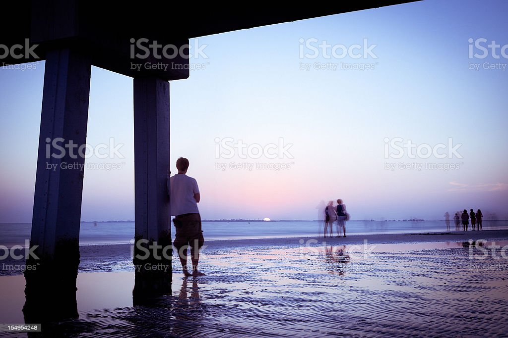 Man staring at the sunset royalty-free stock photo