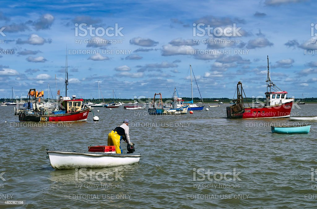 Man starting his boat's outboard motor stock photo