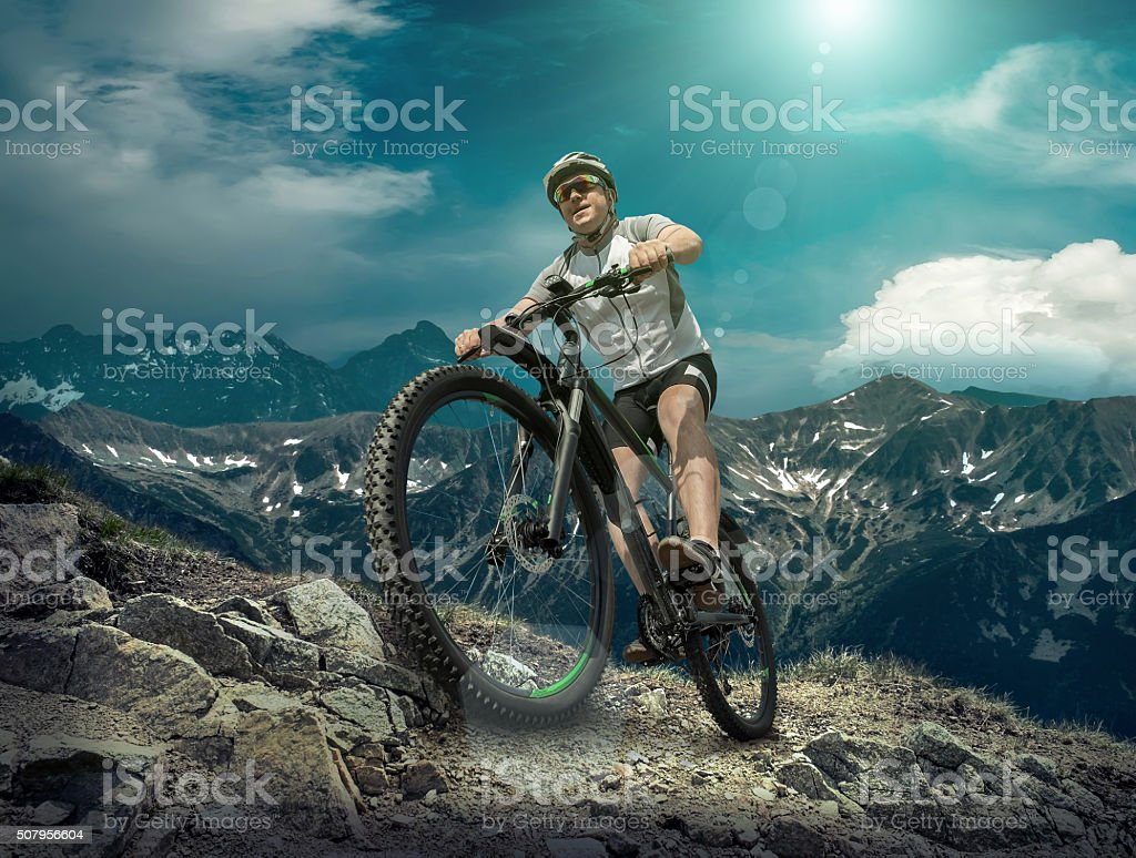 Man stay on the bicycle under sky with clo stock photo