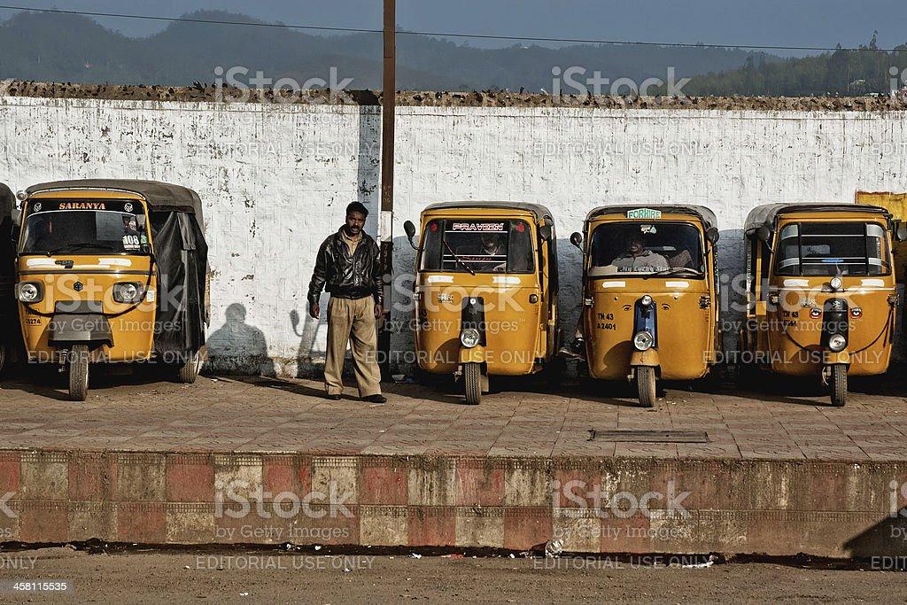 Man staying at auto rickshaw station royalty-free stock photo