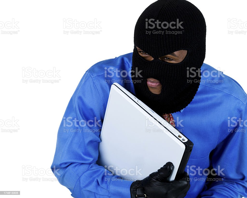 Man stealing a computer royalty-free stock photo