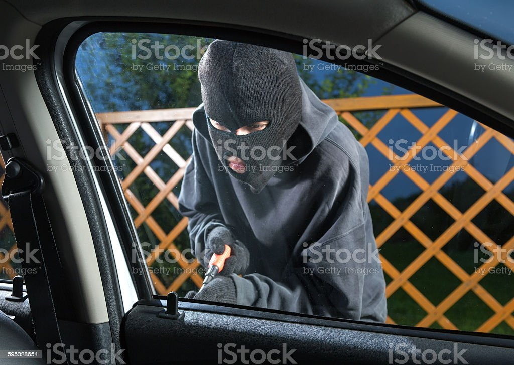 Man stealing car stock photo