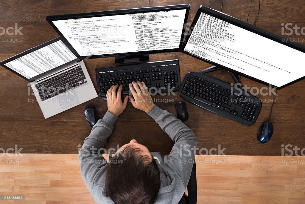 Man Stealing Data From Computers And Laptop stock photo