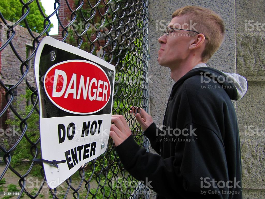 Man Stopped By Do Not Enter Sign stock photo