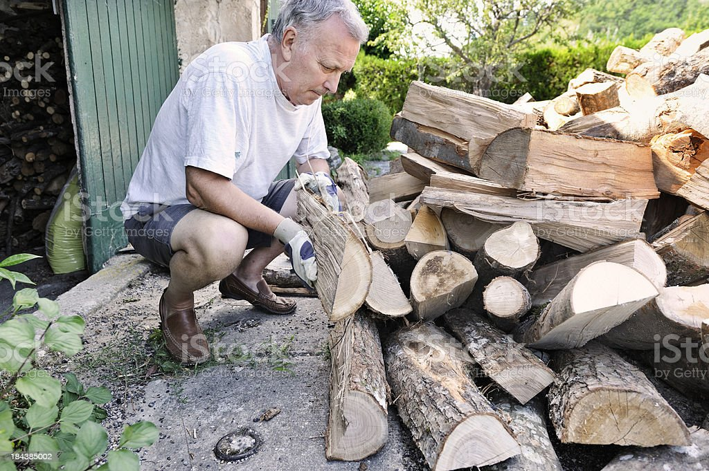 Man storing log delivery stock photo