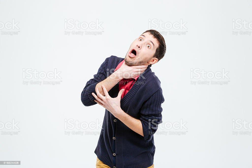 Man strangling herself stock photo