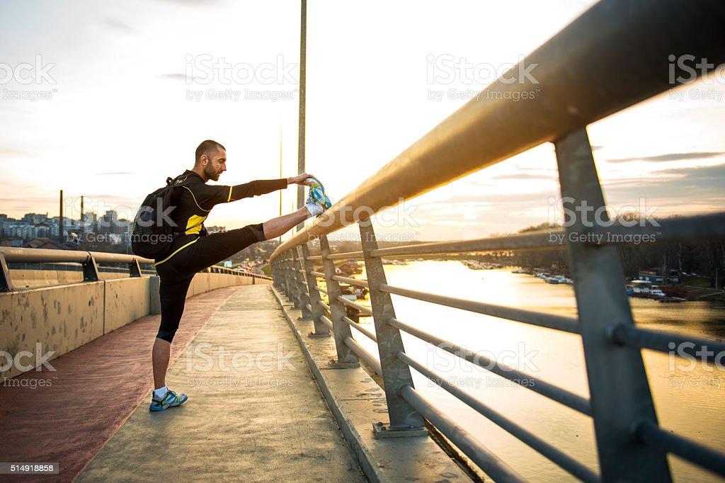 Man streching his leg stock photo