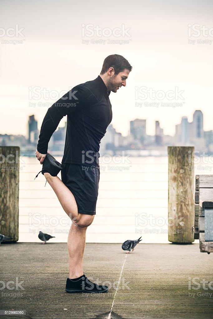 Man Stretching At Seattle Beach stock photo
