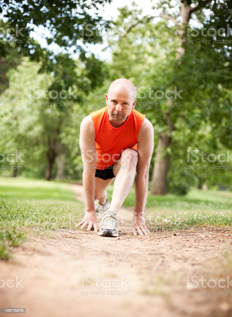 Man stretching before exercising royalty-free stock photo